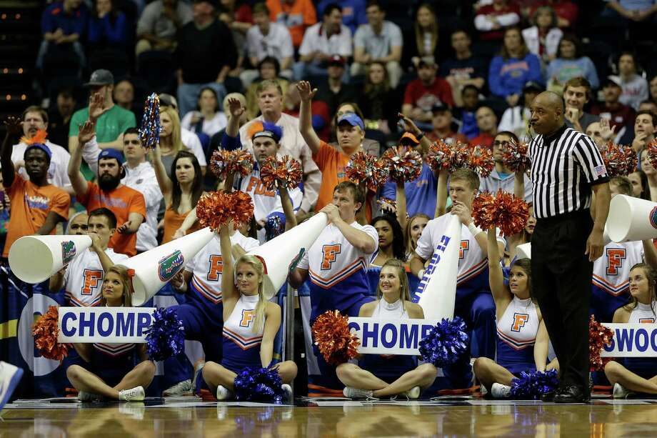 Florida  cheerleaders perform during the second half of an NCAA college basketball game against Alabama in the semifinals of the Southeastern Conference tournament, Saturday, March 16, 2013, in Nashville, Tenn. (AP Photo/Dave Martin) Photo: Dave Martin, Associated Press / AP