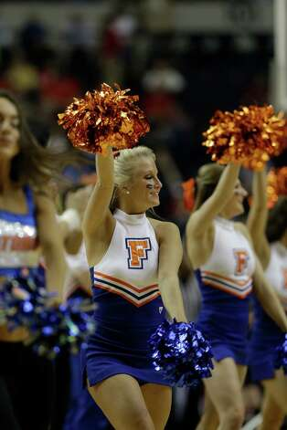 Florida  cheerleaders perform during the first half of an NCAA college basketball game against Alabama at the Southeastern Conference tournament, Saturday, March 16, 2013, in Nashville, Tenn.  (AP Photo/Dave Martin) Photo: Dave Martin, Associated Press / AP
