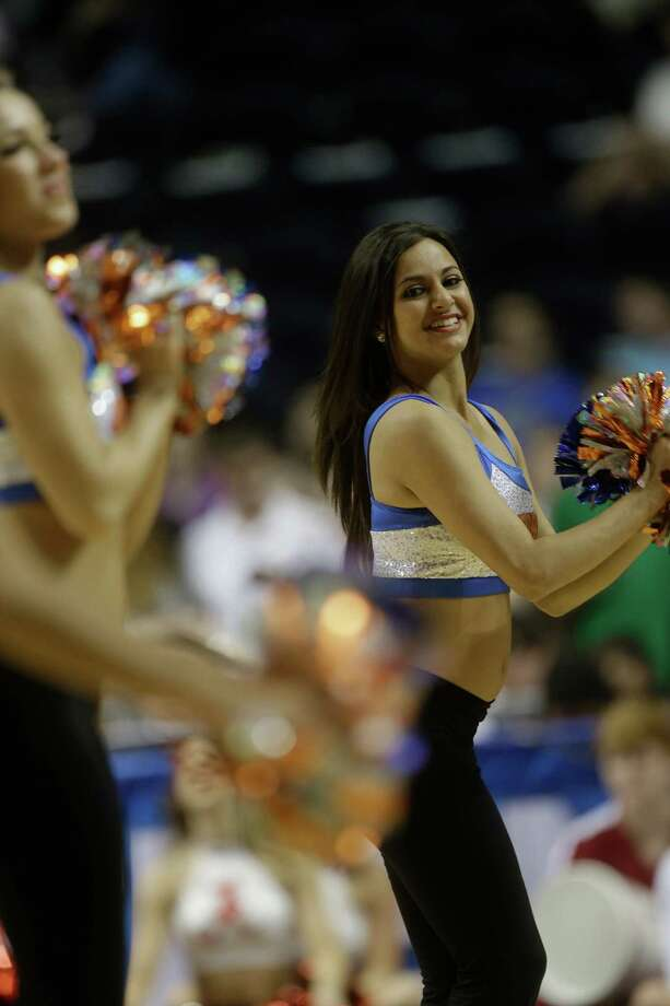 Florida  cheerleaders perform during the first half of an NCAA college basketball game against Alabama at the Southeastern Conference tournament, Saturday, March 16, 2013, in Nashville, Tenn. (AP Photo/John Bazemore) Photo: John Bazemore, Associated Press / AP
