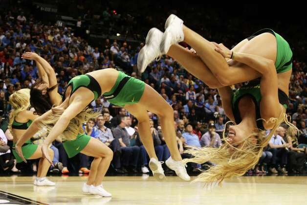 The Oregon Ducks cheerleaders perform in the first half against the UCLA Bruins during the Pac-12 Championship game at MGM Grand Garden Arena on March 16, 2013 in Las Vegas, Nevada. Photo: Jeff Gross, Getty Images / 2013 Getty Images