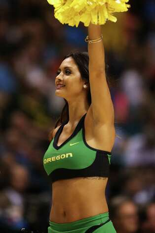 An Oregon Ducks cheerleader performs in the first half against the UCLA Bruins during the Pac-12 Championship game at MGM Grand Garden Arena on March 16, 2013 in Las Vegas, Nevada. Photo: Jeff Gross, Getty Images / 2013 Getty Images