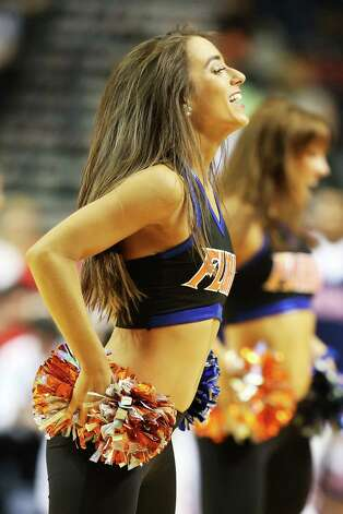 Florida Gators cheerleaders perform in the first half against the Ole Miss Rebels during the SEC Basketball Tournament Championship game at Bridgestone Arena on March 17, 2013 in Nashville, Tennessee. Photo: Andy Lyons, Getty Images / 2013 Getty Images