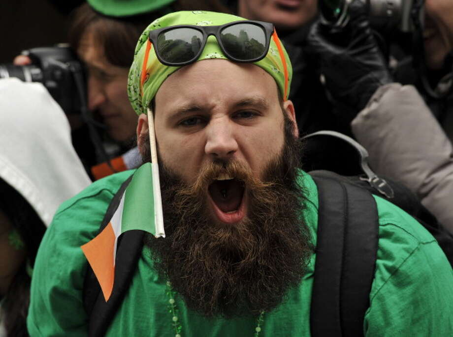 A parade-goer watches as marching bands make their way  up 5th Avenue during the 252th New York City St. Patrick's Day Parade on March 16, 2013.    AFP PHOTO/TIMOTHY A. CLARY        (Photo credit should read TIMOTHY A. CLARY/AFP/Getty Images) Photo: TIMOTHY A. CLARY, AFP/Getty Images / Getty Images