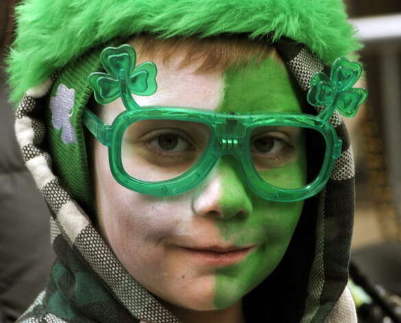 A parade-goer watches marching bands make their way  up 5th Avenue during the 252th New York City St. Patrick's Day Parade on March 16, 2013.    AFP PHOTO/TIMOTHY A. CLARY        (Photo credit should read TIMOTHY A. CLARY/AFP/Getty Images) Photo: TIMOTHY A. CLARY, AFP/Getty Images / Getty Images