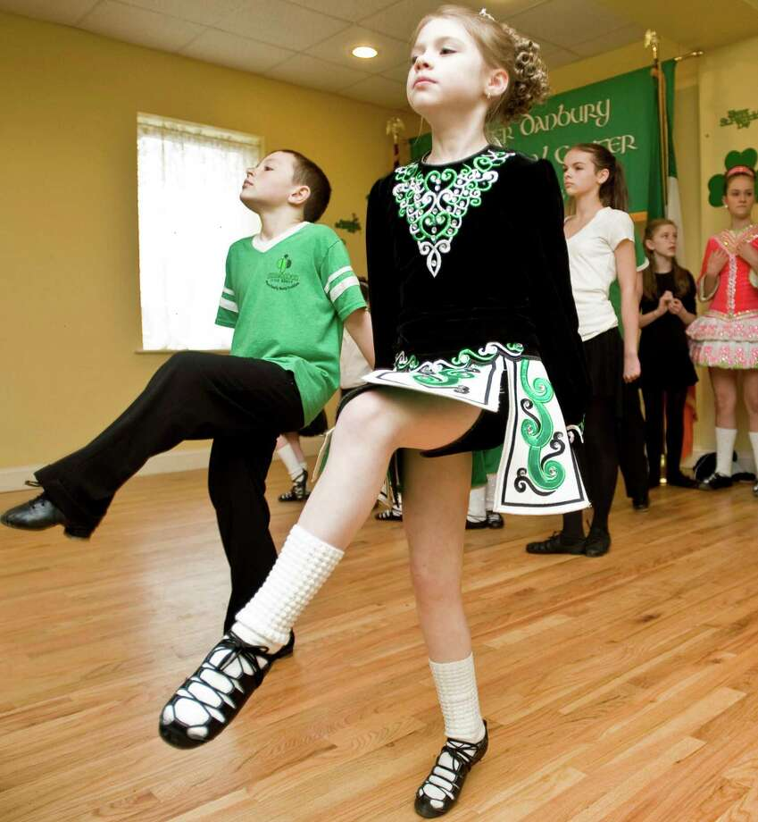 Gilleoghan School of Irish Dance students Ciaran Vizi, 8, of Bethel and Madeline Brietbel, 8, of New Fairfield, perform an Irish dance at the Greater Danbury Irish Cultural Center. Sunday, Mar. 17, 2013 Photo: Scott Mullin