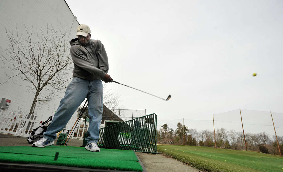 Thomas Way, of Stamford, hits the ball at the driving range at Sterling Farms Golf Club in Stamford on Monday, March 11, 2013.