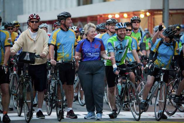 Mayor Annise Parker waits joins riders for a group photo at Tour de Houston, March 17, 2013 in Houston. Photo: Eric Kayne, For The Chronicle / © 2013 Eric Kayne