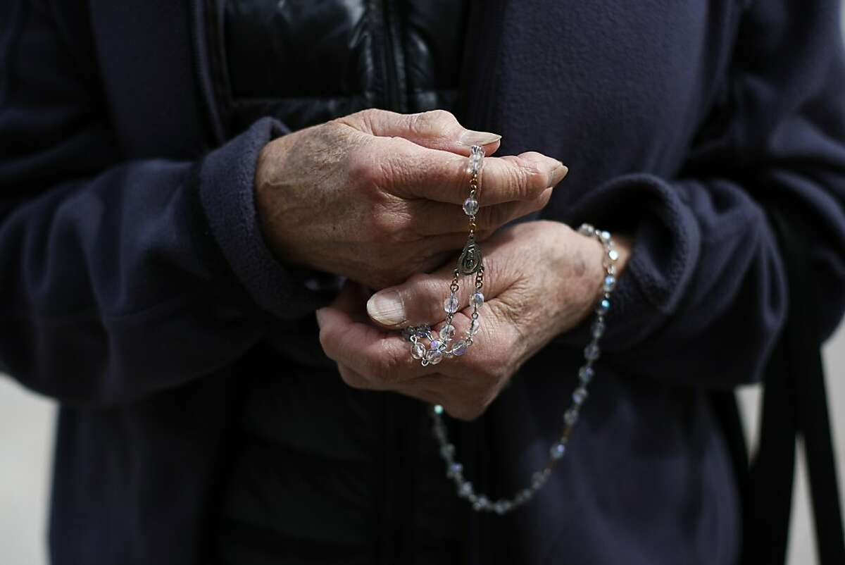 A woman prays the Rosary in front of Planned Parenthood on 1650 Valencia St. in San Francisco, Calif. on Friday, March 15. San Francisco Supervisor David Campos wants to put a 25-foot bubble around reproductive health care facilities to protect clients from aggressive protesters.