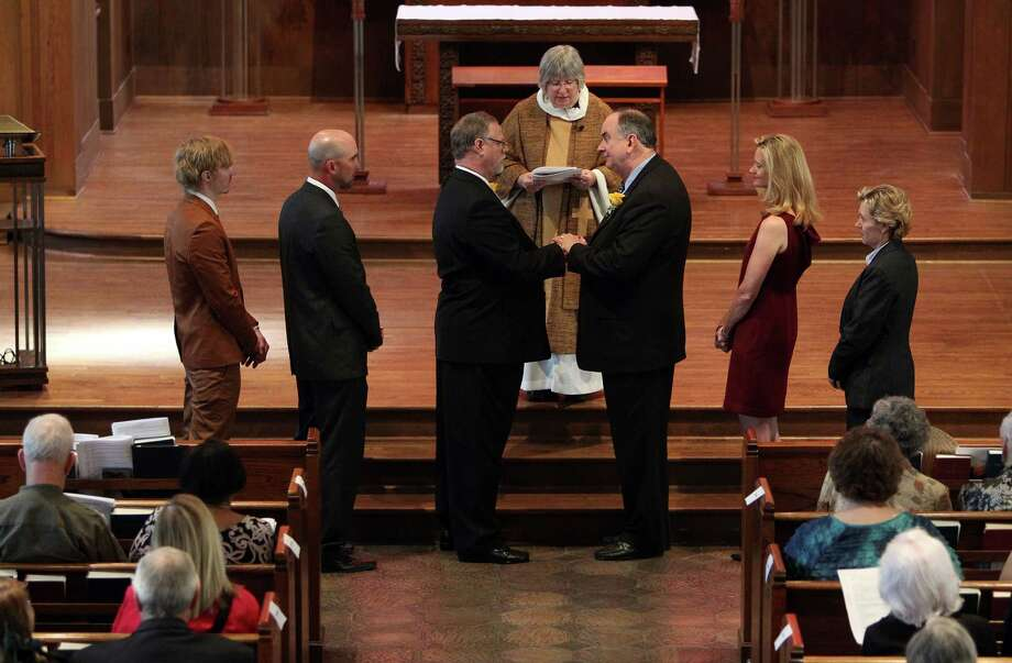 Jeff Meadows and Gary Patterson face each other to say The Commitment during The Witness and Blessing of a Lifelong Covenant at St. Stephen's Episcopal Church on Sunday, March 17, 2013, in Houston. Photo: Mayra Beltran, Houston Chronicle / © 2013 Houston Chronicle