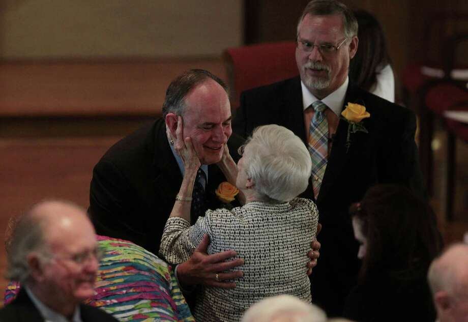 Gary Patterson is congratulated and offered sing of peace during the service as partner Jeff Meadows looks on at St. Stephen's Episcopal Church on Sunday, March 17, 2013, in Houston. Photo: Mayra Beltran, Houston Chronicle / © 2013 Houston Chronicle
