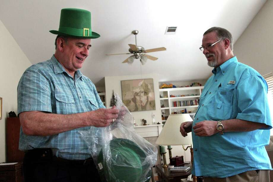 (left to right) Gary Patterson wears a green top hat he would like his partner Jeff Meadows to wear during their reception since the blessing ceremony falls on St. Patrick's Day on Monday, March 11, 2013, in Houston. Patterson and Meadows will be the first couple to participate in the Lifelong Commitment ceremony in Houston after the national church wrote the blessing in the summer of 2012. The Bishop of the Diocese of Texas granted St. Stephen's the opportunity to offer the blessing. Photo: Mayra Beltran, Houston Chronicle / © 2013 Houston Chronicle
