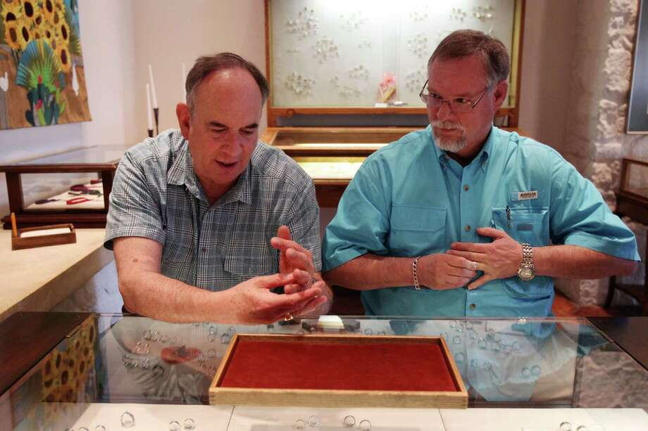 Gary Patterson and Jeff Meadows try on their rings at James Avery jewelry store in preparation for their Lifelong Commitment ceremony at St. Stephen's Episcopal Church on Monday, March 11, 2013, in Houston. Patterson and Meadows will be the first couple to participate in a 'Witnessing and Blessing of a Lifelong Covenant' in Houston after the national church wrote the blessing in the summer of 2012. The Bishop of the Diocese of Texas granted St. Stephen's the opportunity to offer the blessing. Photo: Mayra Beltran, Houston Chronicle / © 2013 Houston Chronicle