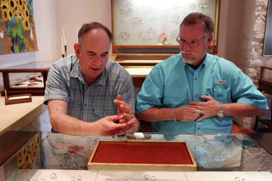 Gary Patterson and Jeff Meadows try on their rings at James Avery jewelry store in preparation for t