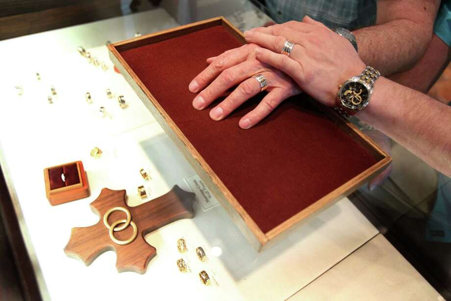 Gary Patterson and Jeff Meadows try on their rings at James Avery, a Christian jewelry store, in preparation for their Lifelong Commitment ceremony at St. Stephen's Episcopal Church on Monday, March 11, 2013, in Houston. Patterson and Meadows will be the first couple to participate in a 'Witnessing and Blessing of a Lifelong Covenant' in Houston after the national church wrote the blessing in the summer of 2012. The Bishop of the Diocese of Texas granted St. Stephen's the opportunity to offer the blessing. Photo: Mayra Beltran, Houston Chronicle / © 2013 Houston Chronicle