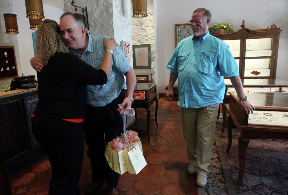 Rachel Price, manager at James Avery, congratulates Gary Patterson and Jeff Meadows after purchasing gifts and having commitment rings cleaned at the Christian  jewelry store in preparation for their blessing ceremony at St. Stephen's Episcopal Church on Monday, March 11, 2013, in Houston. Patterson and Meadows will be the first couple to participate in a 'Witnessing and Blessing of a Lifelong Covenant' in Houston after the national church wrote the blessing in the summer of 2012. The Bishop of the Diocese of Texas granted St. Stephen's the opportunity to offer the blessing. Photo: Mayra Beltran, Houston Chronicle / © 2013 Houston Chronicle