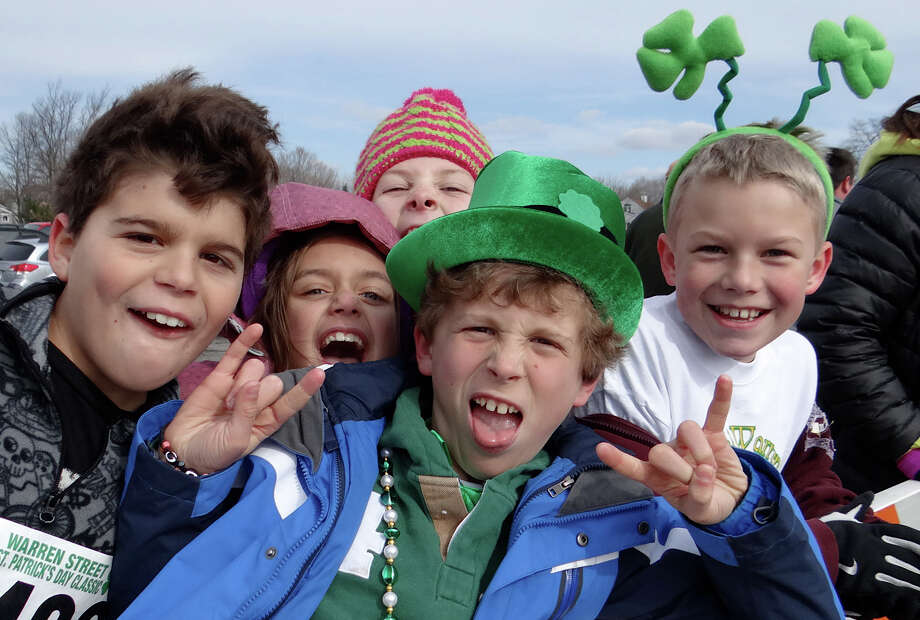 Cheering on runners in St. Patrick's Day road races at Jennings Beach were Thomas Meireles, Chloe Zako, Lauren Miller, Christian Miller and Landon Heatly on Sunday morning.  FAIRFIELD, CT 3/17/13 Photo: Mike Lauterborn / Fairfield Citizen contributed