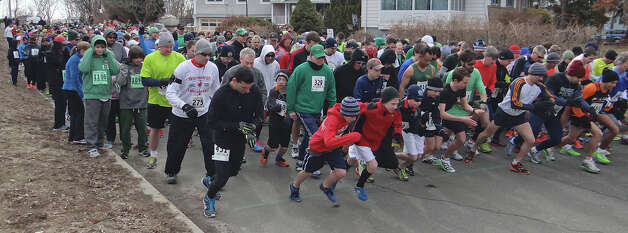 Hundreds of runners set off early Sunday on South Benson Road in the Warren Street Social Club's St. Patrick's Day Classic 4-Mile Road Race.  FAIRFIELD CITIZEN, CT 3/17/13 Photo: Mike Lauterborn / Fairfield Citizen contributed