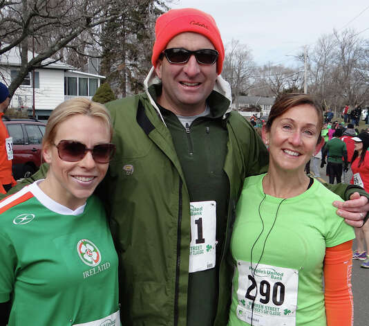Fairfielders Kelly Takacs, Ted O'Neill and Keri O'Neill get ready to run in the St. Patrick's Day 4-Mile Road Race on Sunday.  FAIRFIELD CITIZEN, CT 3/17/13 Photo: Mike Lauterborn / Fairfield Citizen contributed