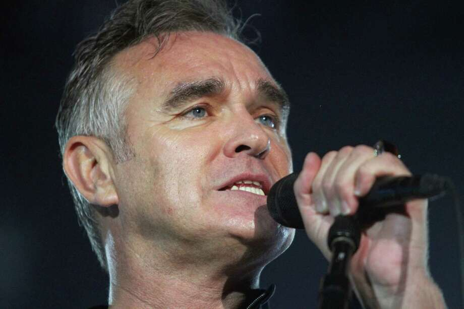 FILE - In this July 21, 2012 file photo, British rock singer Morrissey, the former front man of the alternative rock group The Smiths, sings during his concert in Tel Aviv, Israel.   Health concerns are forcing Morrissey to cancel his North American tour. In a statement released Friday night, his rep says the singer has to take a break after suffering a series of maladies, including double pneumonia, a bleeding ulcer and a gastrointestinal problem called Barrett's esophogas. (AP Photo/Dan Balilty, File) Photo: Dan Balilty
