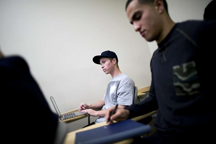 Clay Smith (left) says fall semester at Berkeley City College was the most hectic he has seen, with at least 10 fellow students standing in every class after courses were cut. Photo: Michael Short, California Watch