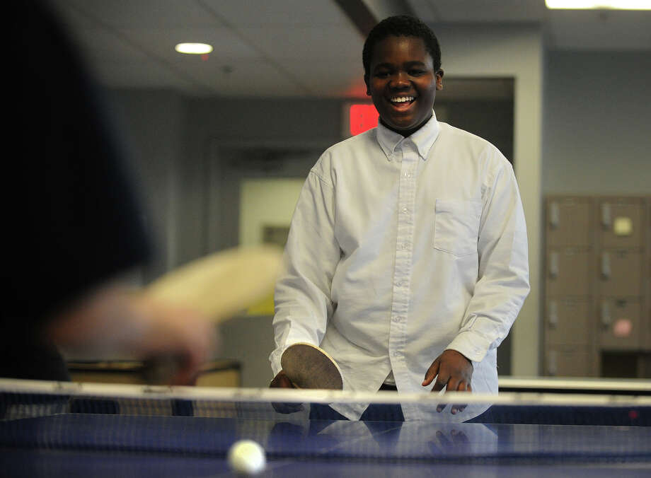 Tavary Atkins, 12 of Bridgeport, has a laugh during a game of table tennis at the Wakeman Boys & Girls Club Smilow-Burroughs Clubhouse in Bridgeport, Conn. on Wednesday, March 13, 2013 Photo: Brian A. Pounds / Connecticut Post