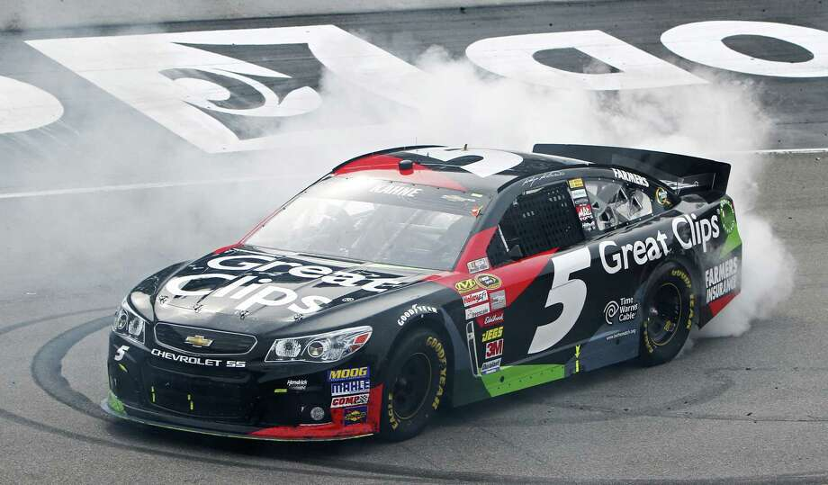 NASCAR Sprint Cup Series driver Kasey Kahne (5) does a burnout after winning the Food City 500 auto race, Sunday, March 17, 2013, in Bristol, Tenn. (AP Photo/Wade Payne) Photo: Wade Payne