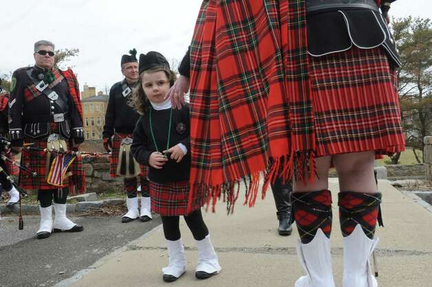 Madeline MacLennan, 4, with her grandfather, Don MacLennan, of Westchester Firefighters Emerald Society, gets ready for the Greenwich's 39th annual St. Patrick's Day parade at Greenwich Avenue, in Greenwich, Conn., March 17, 2013. Photo: Helen Neafsey / Greenwich Time