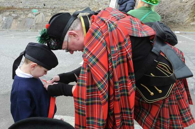 Richie McMurray, 5, gets ready from grandfather Don MacLennan, of Westchester Firefighters Emerald Society at the Greenwich's 39th annual St. Patrick's Day parade at Greenwich Avenue, in Greenwich, Conn., March 17, 2013. Photo: Helen Neafsey / Greenwich Time