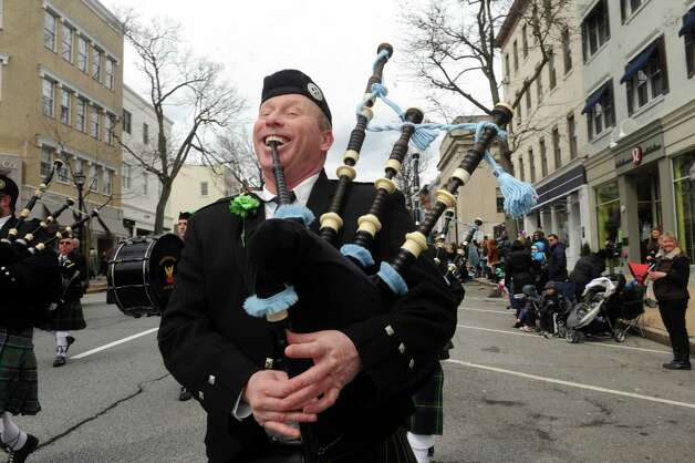 Drew Kennedy of the Greenwich Pipes & Drums enjoy the GreenwichâÄôs 39th annual St. PatrickâÄôs Day parade at Greenwich Avenue, in Greenwich, Conn., March 17, 2013. Photo: Helen Neafsey / Greenwich Time