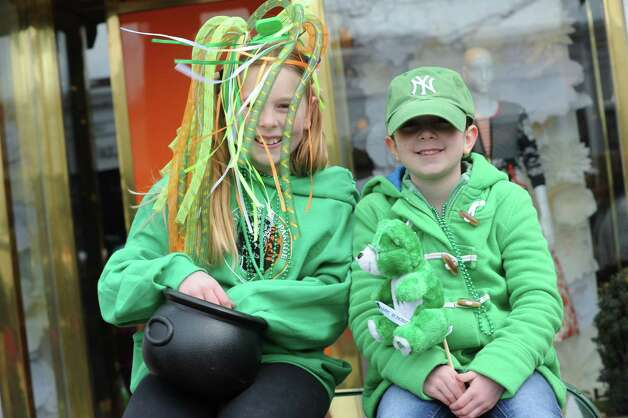 Maggie Ullrich, and Alanna Restrepo, 6, of Cos Cob, watch the GreenwichâÄôs 39th annual St. PatrickâÄôs Day parade at Greenwich Avenue, in Greenwich, Conn., March 17, 2013. Photo: Helen Neafsey / Greenwich Time