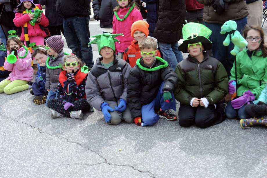 Children watches the GreenwichâÄôs 39th annual St. PatrickâÄôs Day parade at Greenwich Avenue, in Greenwich, Conn., March 17, 2013. Photo: Helen Neafsey / Greenwich Time