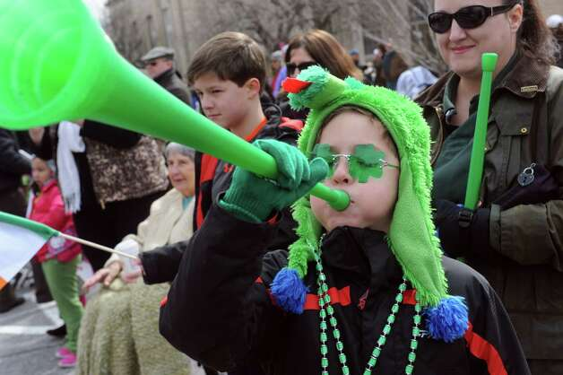 Ben Woodworth, 8, of Greenwich, plays a green horn, at GreenwichâÄôs 39th annual St. PatrickâÄôs Day parade at Greenwich Avenue, in Greenwich, Conn., March 17, 2013. Photo: Helen Neafsey / Greenwich Time