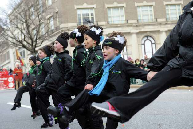 Lily Atkinson, 7, of Stamford, right, did a Irish dance at GreenwichâÄôs 39th annual St. PatrickâÄôs Day parade at Greenwich Avenue, in Greenwich, Conn., March 17, 2013. Photo: Helen Neafsey / Greenwich Time