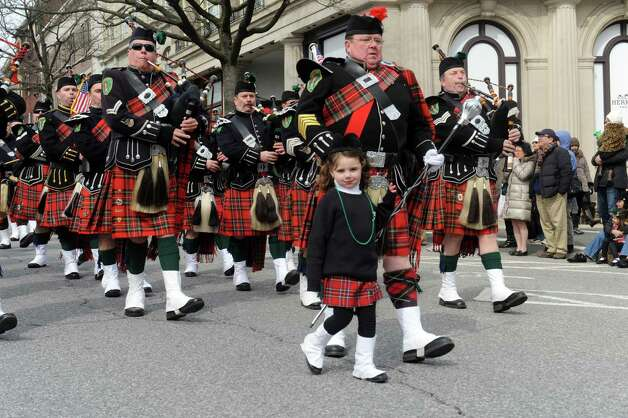 Madeline MacLennan, 4, and Don MacLannan, of Westchester Firefighters Emerald Society, march at GreenwichâÄôs 39th annual St. PatrickâÄôs Day parade at Greenwich Avenue, in Greenwich, Conn., March 17, 2013. Photo: Helen Neafsey / Greenwich Time