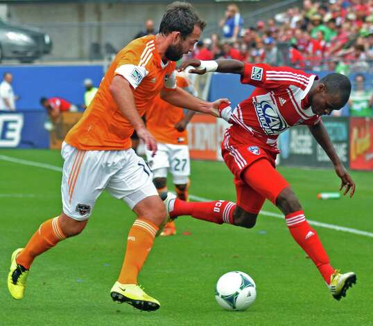 Houston Dynamo's Adam Moffat (16) grabs the jersey of FC Dallas' Jackson Goncalves (6) during an MLS soccer match, Sunday, March 17, 2013, in Frisco, Texas. FC Dallas won 3-2. (AP Photo/The Dallas Morning News, Mark M. Hancock) MANDATORY CREDIT; MAGS OUT; TV OUT; INTERNET OUT; AP MEMBERS ONLY Photo: Mark M. Hancock, Associated Press / The Dallas Morning News