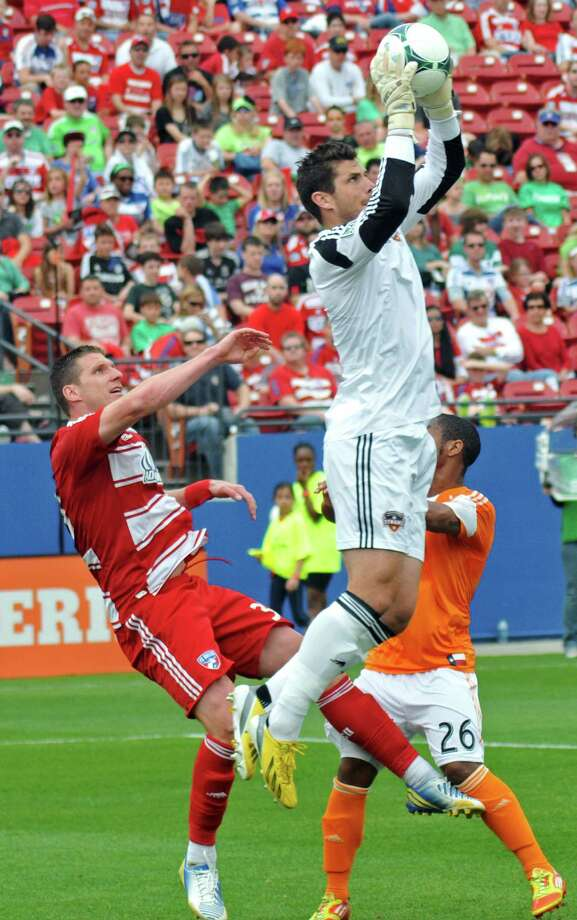 Houston Dynamo goalkeeper Tally Hall (1) intercepts a pass intended for FC Dallas' Kenny Cooper (33) during an MLS soccer match, Sunday, March 17, 2013, in Frisco, Texas. FC Dallas won 3-2. (AP Photo/The Dallas Morning News, Mark M. Hancock) MANDATORY CREDIT; MAGS OUT; TV OUT; INTERNET OUT; AP MEMBERS ONLY Photo: Mark M. Hancock, Associated Press / The Dallas Morning News