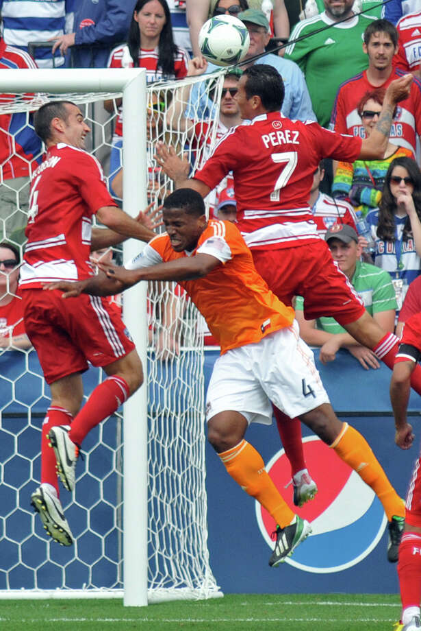 FC Dallas' Blas Perez (7) heads the ball away from the goal during a cornerkick as Andrew Jacobson (4) and Houston Dynamo's Jermaine Taylor (4) also jump in during an MLS soccer match, Sunday, March 17, 2013, in Frisco, Texas. FC Dallas won 3-2. (AP Photo/The Dallas Morning News, Mark M. Hancock) MANDATORY CREDIT; MAGS OUT; TV OUT; INTERNET OUT; AP MEMBERS ONLY Photo: Mark M. Hancock, Associated Press / The Dallas Morning News