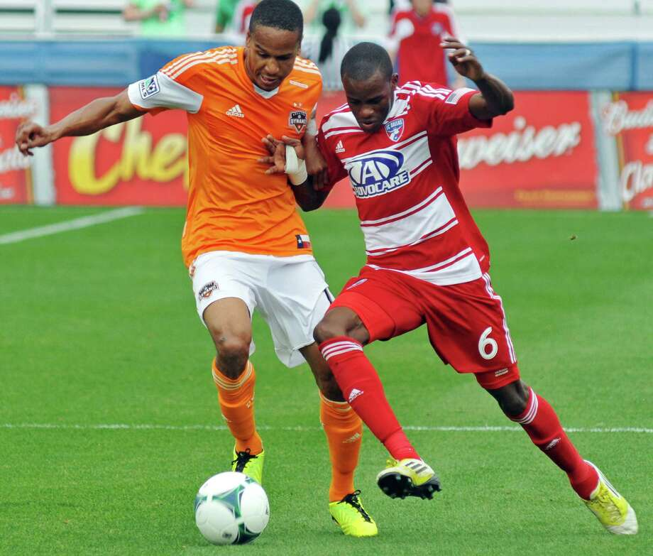 FC Dallas' Jackson Goncalves (6) and Houston Dynamo's Ricardo Clark (13) compete for the ball during an MLS soccer match, Sunday, March 17, 2013, in Frisco, Texas. FC Dallas won 3-2. (AP Photo/The Dallas Morning News, Mark M. Hancock) MANDATORY CREDIT; MAGS OUT; TV OUT; INTERNET OUT; AP MEMBERS ONLY Photo: Mark M. Hancock, Associated Press / The Dallas Morning News
