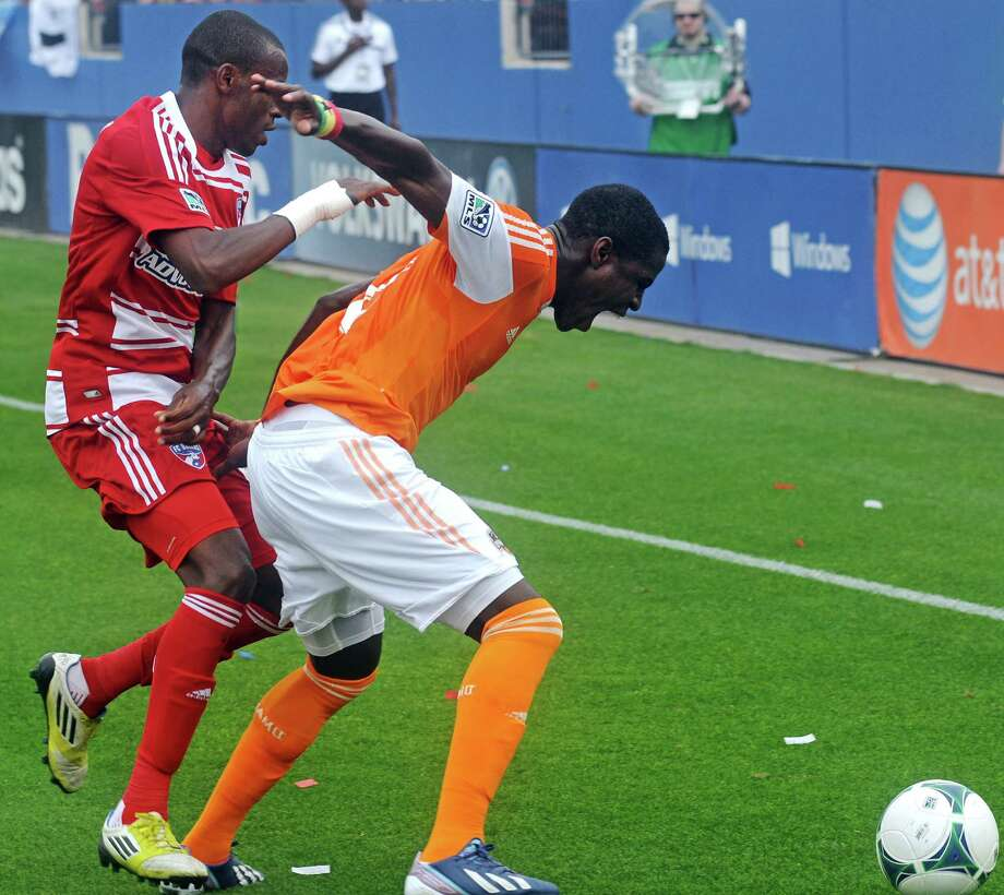 Houston Dynamo's Kofi Sarkodie (8) defends against FC Dallas' Jackson Goncalves (6) during an MLS soccer match, Sunday, March 17, 2013, in Frisco, Texas. FC Dallas won 3-2. (AP Photo/The Dallas Morning News, Mark M. Hancock) MANDATORY CREDIT; MAGS OUT; TV OUT; INTERNET OUT; AP MEMBERS ONLY Photo: Mark M. Hancock, Associated Press / The Dallas Morning News