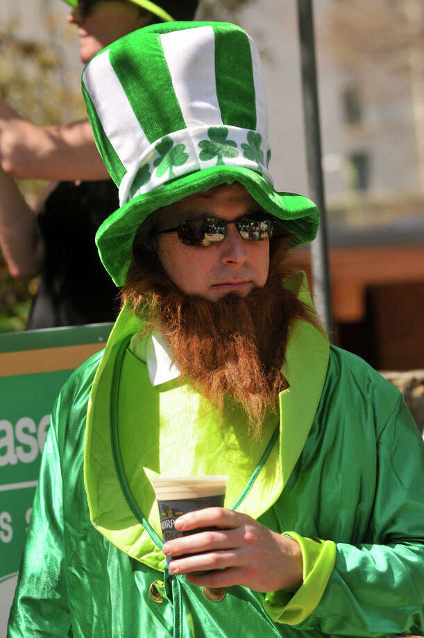Jon Corby of Nashville, Tenn., is dressed for St. Patrick's Day as he awaits the annual parade at the Arneson River Theater Sunday afternoon, March 17, 2013. Photo: Robin Jerstad, For The San Antonio Express-News