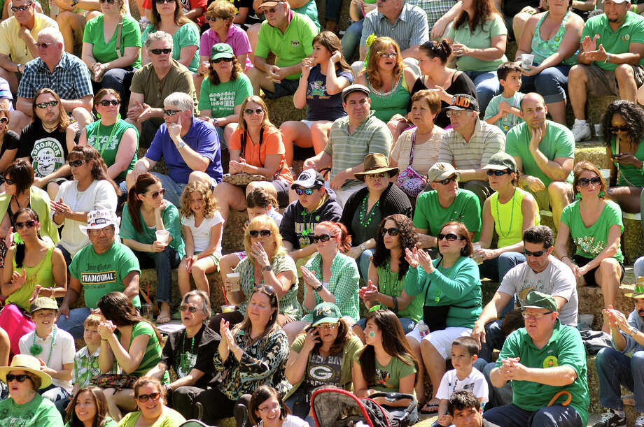 A large crowd at the Arneson River Theater watches the annual St. Patrick's Day River Parade Sunday, March 17, 2013. Photo: Robin Jerstad, For The San Antonio Express-News