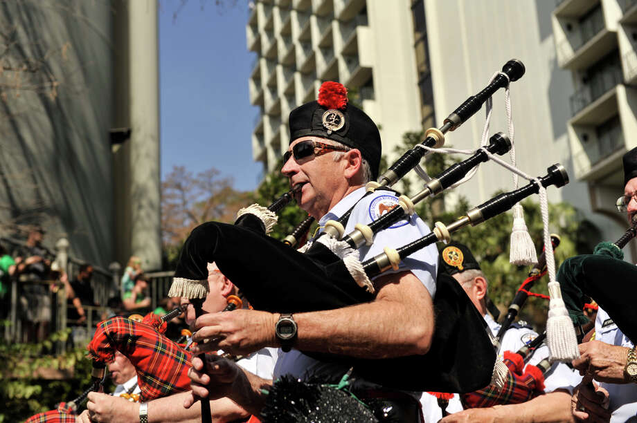 Bagpipers lead the annual St. Patrick's Day Parade along the San Antonio River Sunday afternoon, March 17, 2013. Photo: Robin Jerstad, For The San Antonio Express-News
