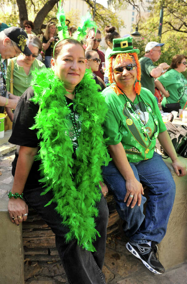 Norma Faz and Vicky Sanchez of San Antonio are dressed for St. Patrick's Day as they await the annual parade at the Arneson River Theater Sunday afternoon, March 17, 2013. Photo: Robin Jerstad, For The San Antonio Express-News