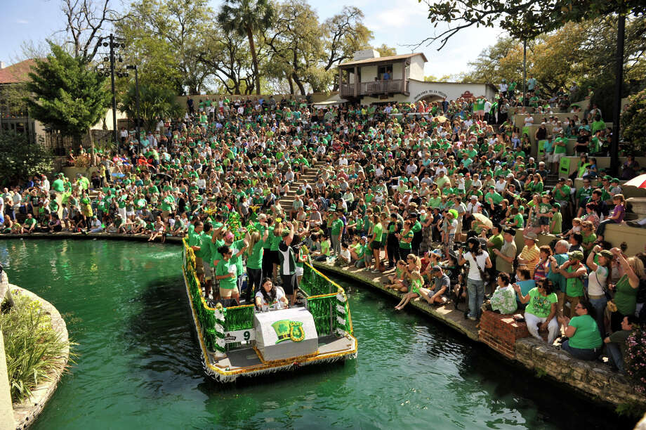 The St. Patrick's Day River Parade passes through the Arneson River Theater in a dyed-green San Antonio River Sunday afternoon, March 17, 2013. Photo: Robin Jerstad, For The San Antonio Express-News