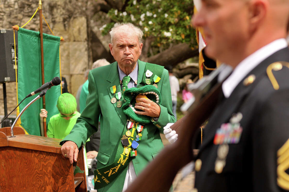 The Rev. William Merriman, chaplain of the Harp and Shamrock Society of Texas, stands as the colors are presented during a ceremony to honor the Irishman who were killed in the Battle of the Alamo Sunday, March 17, 2013, at the Shrine.