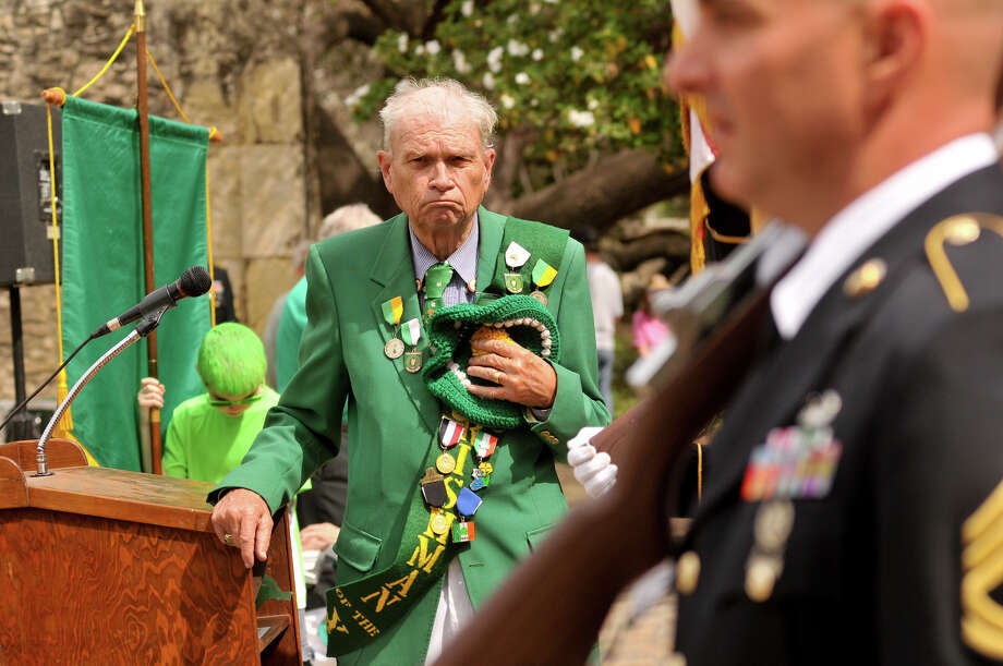 The Rev. William Merriman, chaplain of the Harp and Shamrock Society of Texas, stands as the colors are presented during a ceremony to honor the Irishman who were killed in the Battle of the Alamo Sunday, March 17, 2013, at the Shrine. Photo: Robin Jerstad, For The San Antonio Express-News