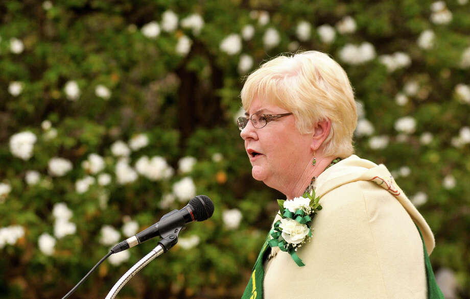 Irishman of the Year Mary Jo Quinn speaks during a ceremony Sunday, March 17, 2013, to honor Irishman who died during the Battle of the Alamo. Photo: Robin Jerstad, For The San Antonio Express-News