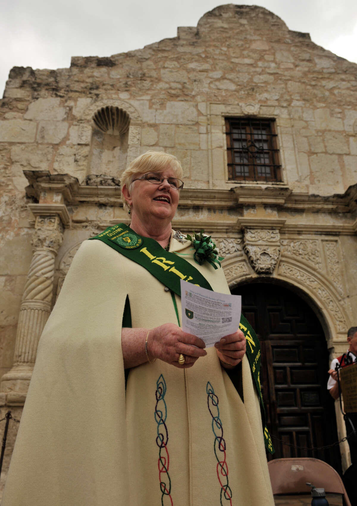 Irishman of the Year Mary Jo Quinn waits for the beginning of a ceremony Sunday, March 17, 2013, to honor Irishman who died during the Battle of the Alamo.