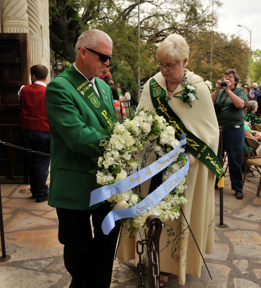 Harp and Shamrock Society of Texas President Kevin Dowd and Irishman of the Year Mary Jo Quinn place a wreath to honor the Irishmen who died at the Battle of the Alamo during a ceremony at the Alamo Sunday, March 17, 2013. Photo: Robin Jerstad, For The San Antonio Express-News