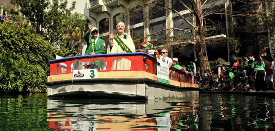Kevin Dowd, President of the Harp and Shamrock Society of Texas and Irishman of the Year Mary Jo Quinn wave to spectators during the annual St. Patrick's Day Parade on the dyed-green San Antonio Sunday, March 17, 2013. Photo: Robin Jerstad, For The San Antonio Express-News